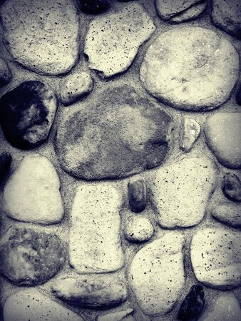 A close up on a stone wall background. Stock Photo