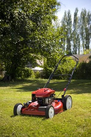 A red lawn mower in fresh cut grass.
