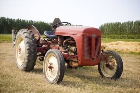 An old red tractor at a U Pick berry farm in the Pacific Northwest.