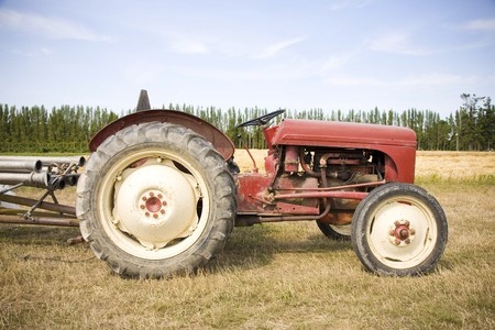 old farm: An old red tractor at a U Pick berry farm in the Pacific Northwest.