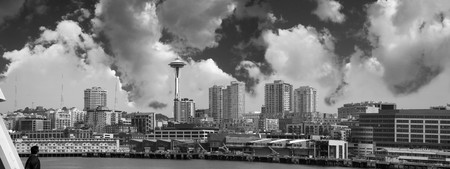 The Seattle skyline as seen from the water. Panoramic image with a man in the foreground enjoying the view. Stock Photo - 4383237