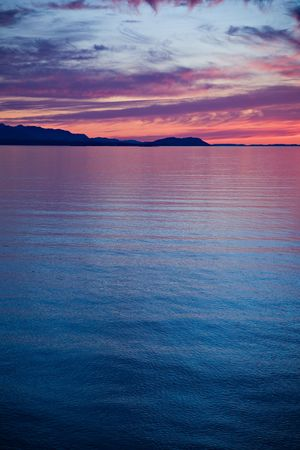 strait of juan de fuca: A beautiful sunset over the Strait of Juan de Fuca in Sequim, Washington. Stock Photo