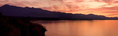strait of juan de fuca: A beautiful sunset over the Strait of Juan de Fuca in Sequim. Panoramic photo. Stock Photo