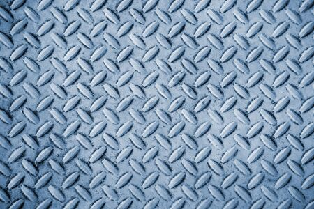 ironworks: A close up on an industrial metal background texture.