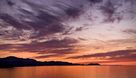 A beautiful sunset over the Strait of Juan de Fuca in Sequim. Panoramic photo. Stock Photo