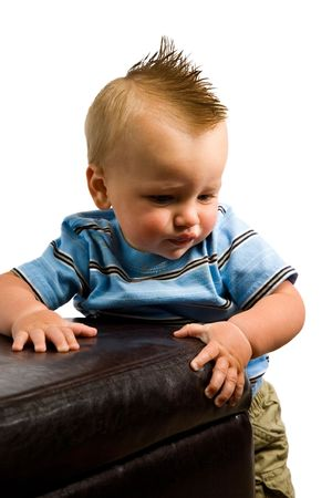 A portrait of a cute nine month old boy isolated on a while background.