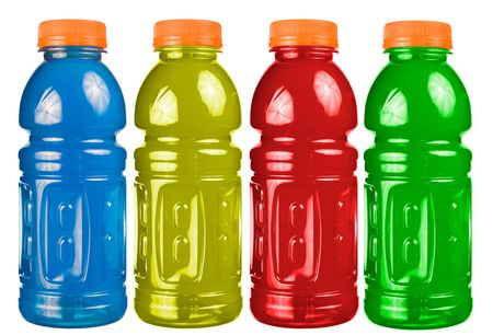 A close up on a set of isolated sports drink bottles. Imagens