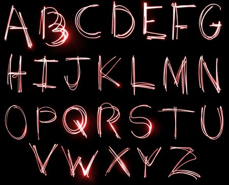 An abstract illustration of the alphabet created with light.