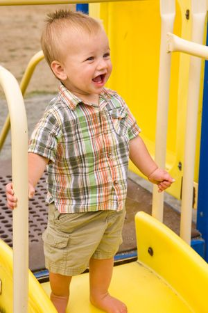 A portrait of a cute one year old baby boy at a park. Stock Photo