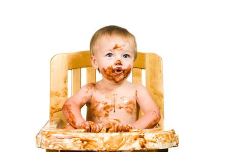 A portrait of a messy baby boy isolated eating chocolate. Stock Photo - 6000903