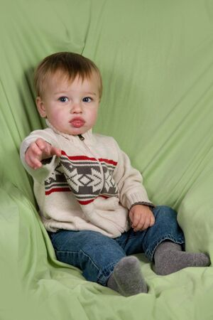 A portrait of a cute toddler dressed in winter clothes. photo
