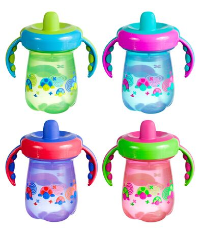 A set of colorful sippy cups isolated on white. Standard-Bild