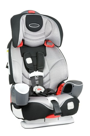 A childs car seat isolated on a white background. Stock Photo