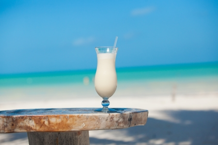 White pina colada on the beach table photo