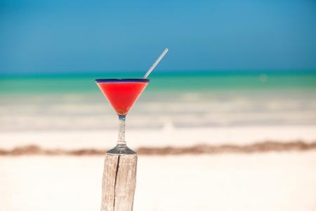 Strawberry margarita on the sandy white beach photo