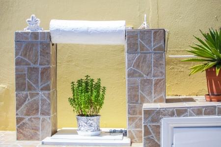 Flowers in white pots in cozy hotel in Santorini photo