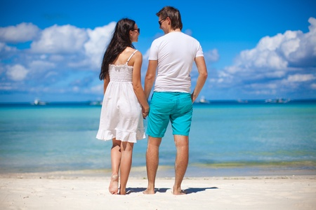 happines: Romantic couple at tropical beach in Philippines look at the sea