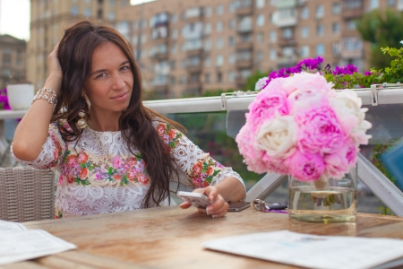 Incredibly beautiful girl at table in restaurant with wonderful bouquet Stock Photo - 21388263