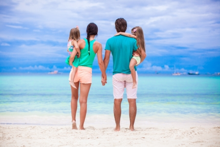 Back view of young family of four looking to the sea in Philippines photo