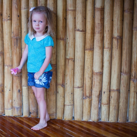 Adorable little girl in exotic tropical resort photo