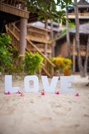 Word love on the sandy beach at beautiful resort photo