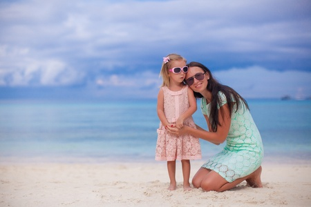 Young beautiful mother and her adorable little daughter enjoy their vacation photo