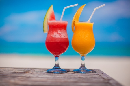 Close up fresh watermelon and mango cocktails on the background of stunning turquoise sea photo