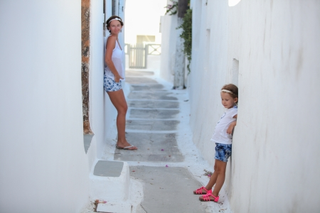 Young mother with her little daughter in a Greek village on the Cyclades Islands photo
