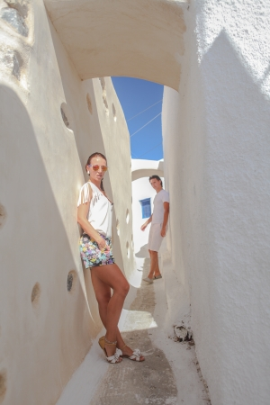 Young woman on the foreground and her husband in the back at Greek village of Emporio
