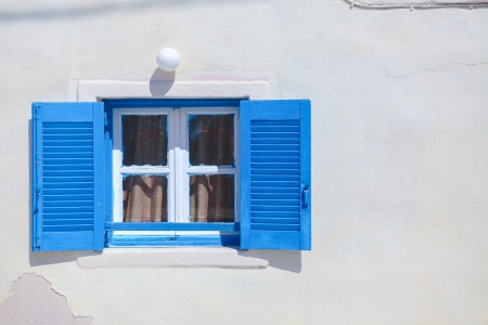Traditional blue greek style windows in Emporio town, Santorini photo