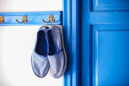 Blue womens slippers in Greek style of house on the Cycladic Islands photo