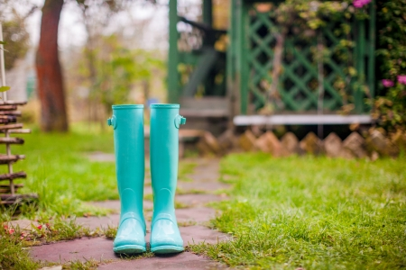 Bright mint rubber boots in the garden  photo