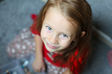5 6: Close-up face of a beautiful blue-eyed little cute girl