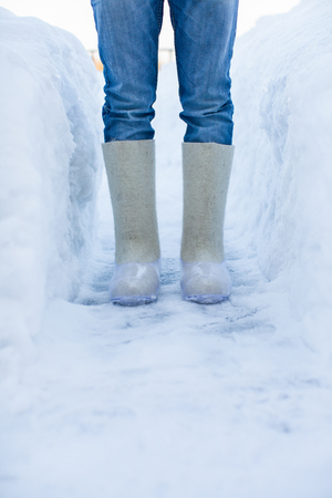 men s feet: Close-up of warm boots for men s feet on the white snow