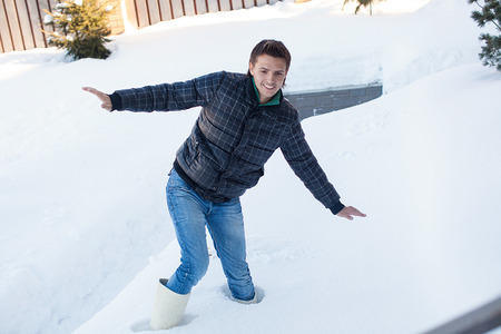 Young man in winter boots fell into a deep white snow Stock Photo - 22803310