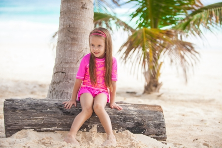 Cute little girl in nice swimsuits have fun at tropical carribean beach,Mexico photo