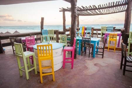 Bright colored bar-restaurant on the white sandy beach in Tulum photo