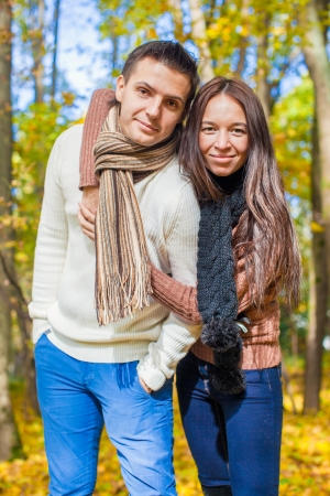 Portrait of Happy couple in love in autumn park on a sunny fall day Stock Photo - 23101033