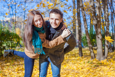 Young Couple having fun in autumn park on a sunny fall day Stock Photo - 23101073