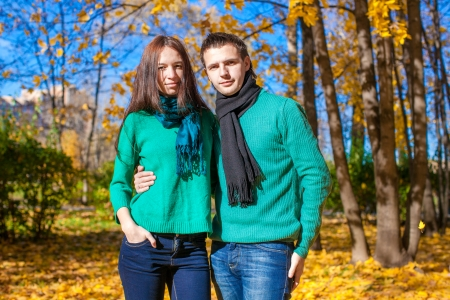 Portrait of Happy couple in autumn park on a sunny fall day Stock Photo - 23101074