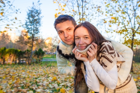 Portrait of Happy couple having fun in autumn park on a sunny fall day Stock Photo - 23101113