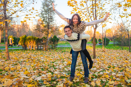 Happy family of two having fun in autumn park on a sunny fall day Stock Photo - 23101115