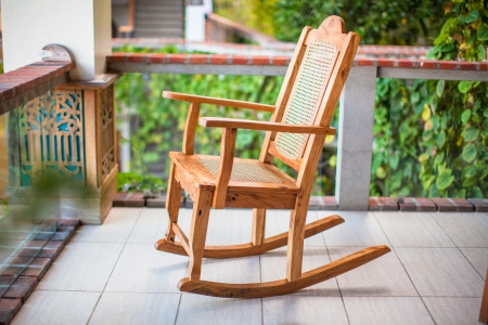 wooden rocking chairs wooden rocking chair on the terrace of an exotic hotel stock photo
