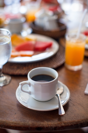 Black coffee, juice and fruits for breakfast at a cafe in the resort photo