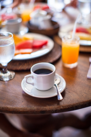 Black coffee and milk for breakfast at a cafe in the resort photo