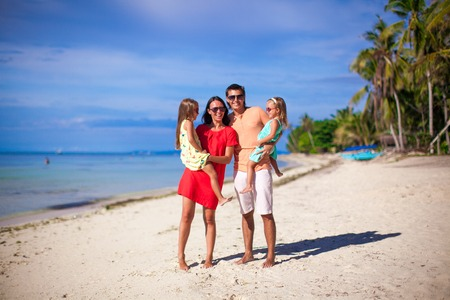 Young family with two kids on summer vacation photo