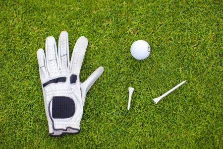 Golf equipment on green grass photo