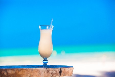 White pina colada on the table on the beach photo