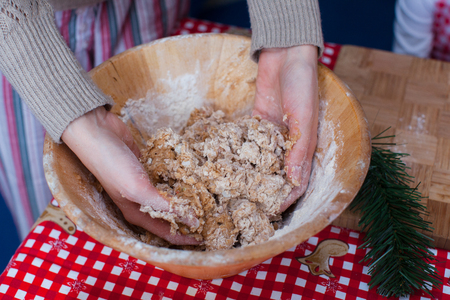 Close-up hands kneading dough for gingerbread at Christmas photo