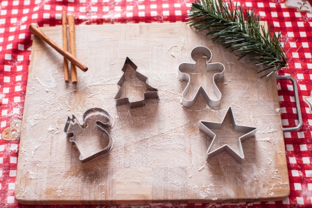 pastry cutters: Christmas shapes pastry cutters on wooden board Stock Photo